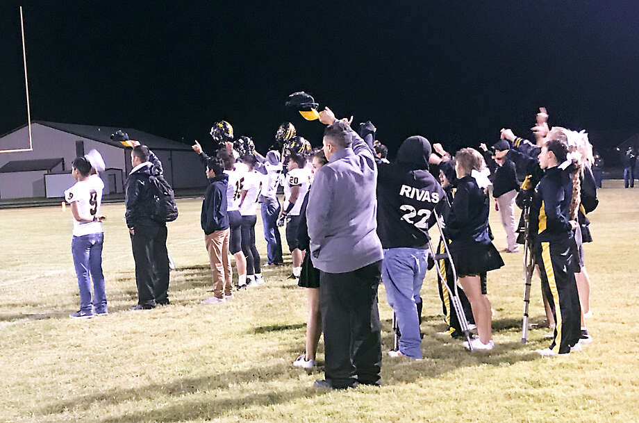 The Petersburg Buffaloes football team performs its postgame ritual as the Petersburg band plays the school song after a 53-6 win over Kress on Friday in Kress. Photo: Alexis Cubit/Plainview Herald