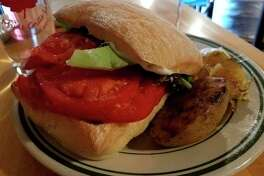 The tomato sandwichat Maple Grille, 13105 Gratiot Road in Hemlock. 'With life changing smoked potatoes and delicata squash on the side, that perfect ciabatta bread, and a beautiful pile of organic tomatoes, you have yourself an awesome sandwich. Homemade mayo with some additions gave it all a nice zip.'(Matthew Woods | for the Daily News)