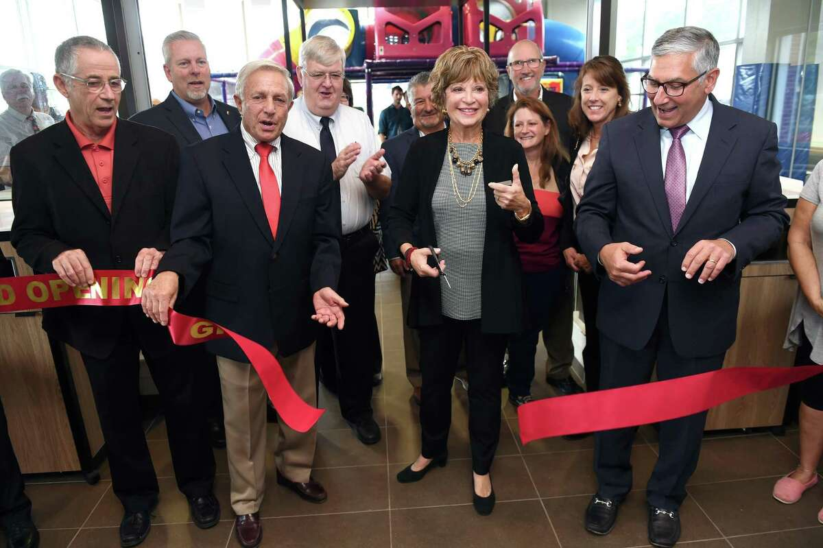 Front row from left, East Haven Mayor Joseph Maturo, Jr., East Haven McDonald's owners, Dick and Kathryn Spero, and State Senator Len Fasano take part in a ribbon cutting ceremony during the grand re-opening of the East Haven McDonald's on October 2, 2018.