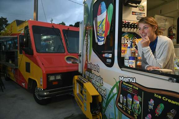 Maddie Koehn, 17, a senior at Concordia Lutheran School, waits for customers at Tikiz Shaved Ice and Ice Cream at 403 Eats, a new food truck park in Tomball, on June 30, 2017. The Tomball city council approved a conditional use permit for the construction of a new food court.