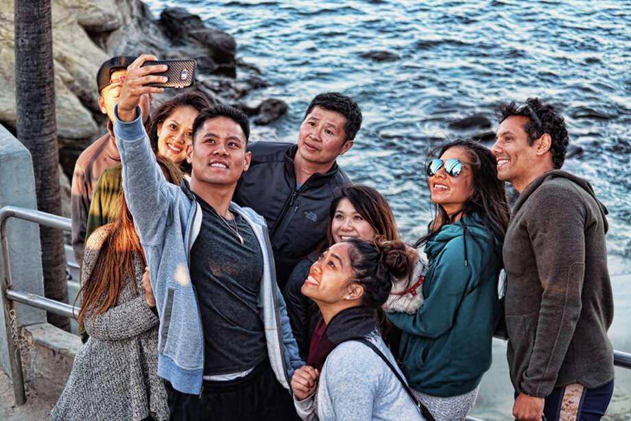 Visitors take a selfie by the sea in La Jolla. Photo: Jim Glab