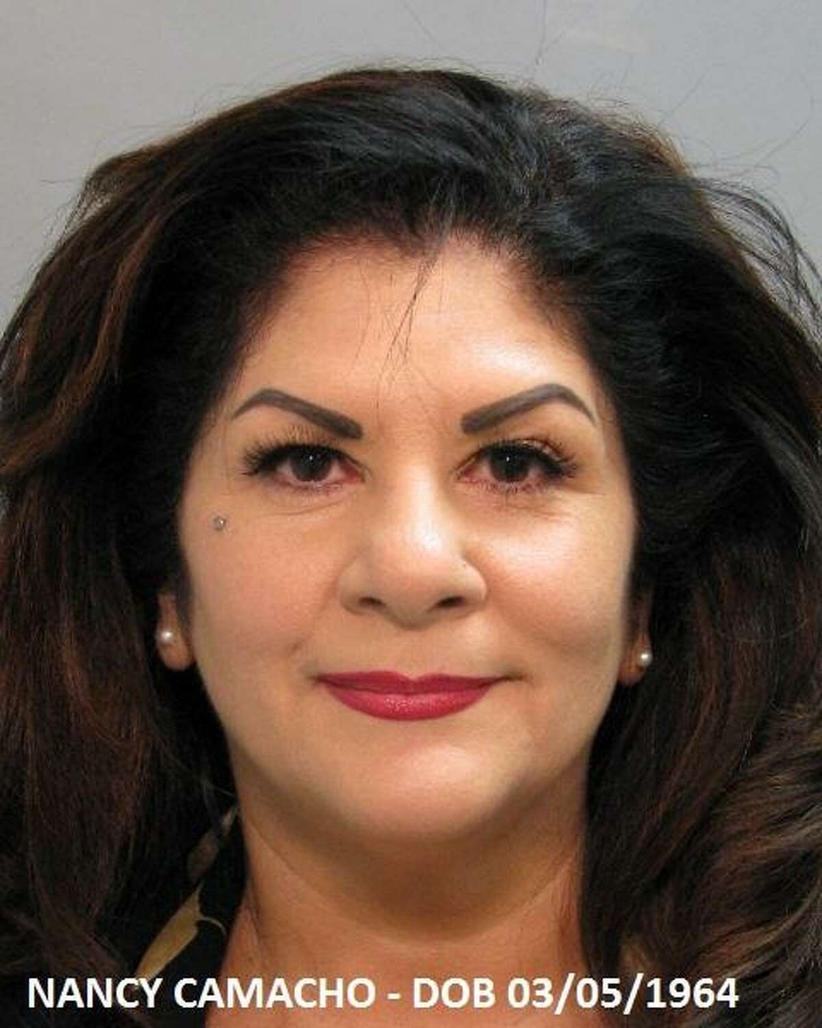 Nancy Camacho was arrested and charged with operating a massage parlor without a license.