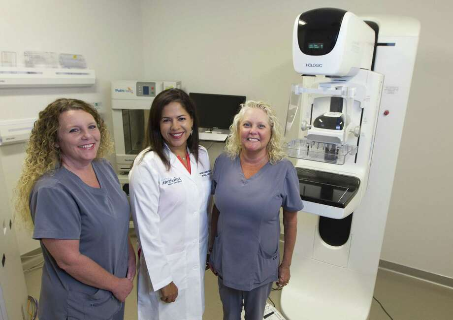 Nurse Annelise Warner, left, poses beside Dr. Magda Ghobashy and nurse Mischele Lolie at Houston Methodist The Woodlands Hospital on Thursday, Sept. 13, 2018, in The Woodlands. The Breast Care Center will soon begin using the radioactive seed localization procedure to prepare breast cancer patients for surgery without using the uncomfortable wire localization method. Photo: Jason Fochtman, Houston Chronicle / Staff Photographer / © 2018 Houston Chronicle