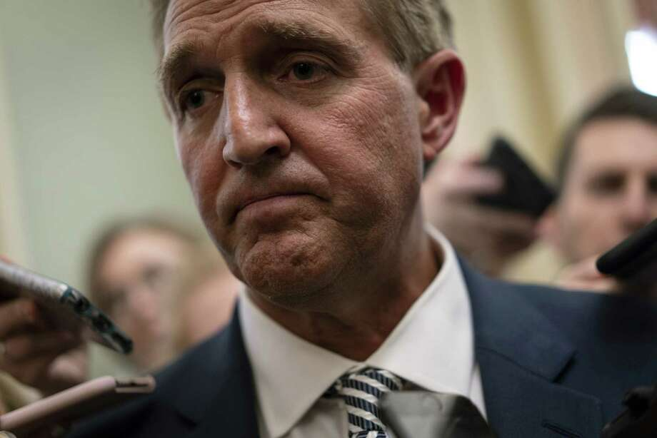 Sen. Jeff Flake, R-Ariz., speaks with the media at the U.S. Capitol in Washington on Sept. 28, 2018. Photo: Bloomberg Photo By Aaron P. Bernstein. / © 2018 Bloomberg Finance LP