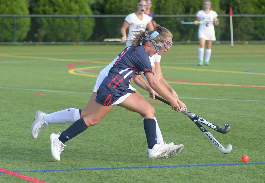 Greens Farms Academy field hockey player Keely O'Shea, a resident of Darien, races a Rye Country Day opponent to the ball during a game last week in Westport. Photo: Contributed Photo
