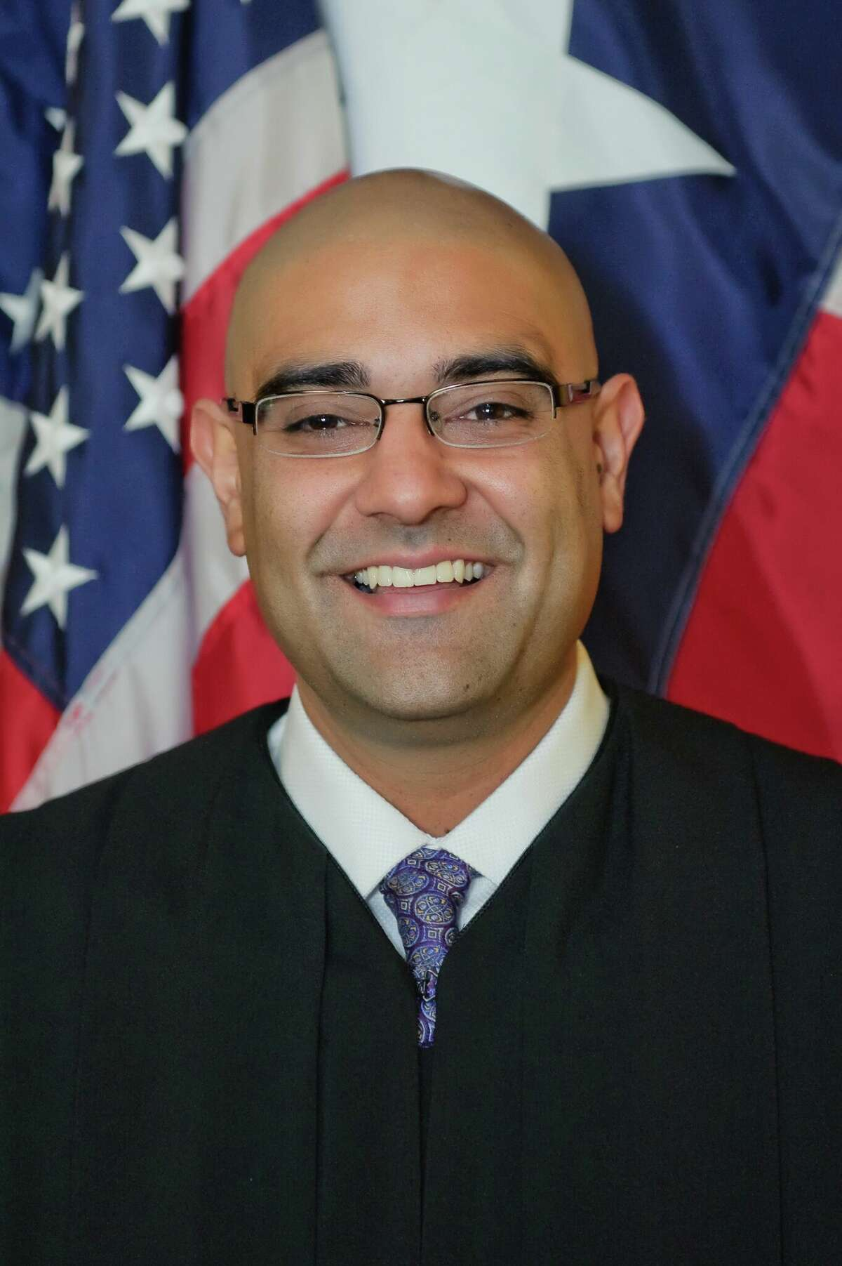 R.K. Sandill, (D), candidate for Supreme Court, Place 4.