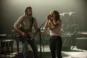 "This image released by Warner Bros. shows Bradley Cooper, left, and Lady Gaga in a scene from the latest reboot of the film, ""A Star is Born."" (Neal Preston/Warner Bros. via AP)"