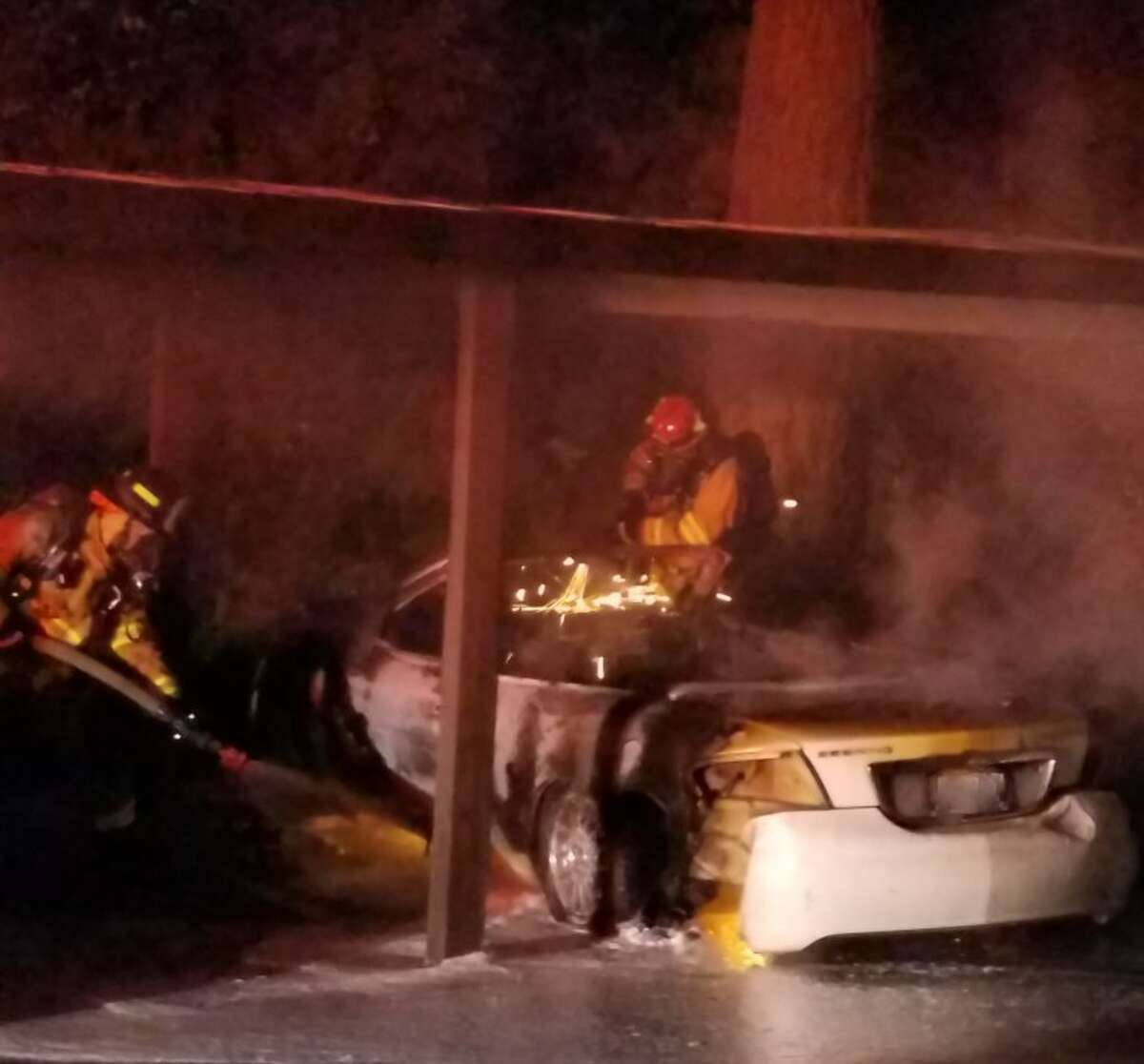 Fire crews put out a vehicle fire caused by an unknown arsonist in the early hours of Sept. 28 in Redmond.