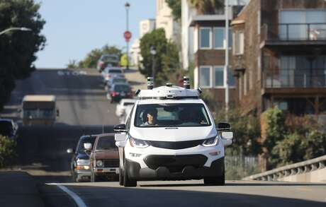 FILE-- General Motors debuts its new self driving vehicle at a press event in San Francisco, Nov. 28, 2017. Honda will take a $750 million stake in Cruise, GM's self-driving car venture, and commit $2 billion over 12 years in the race to develop fully autonomous vehicles. (Jim Wilson/The New York Times)