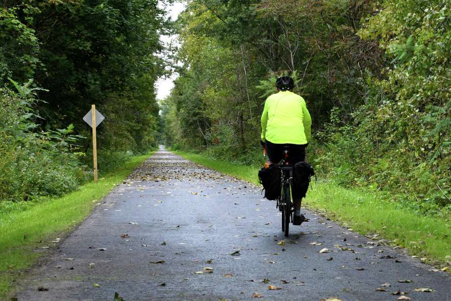 John Major of Rotterdam takes a ride on a newly opened 5-mile section of the Erie Canalway Trail at the Pattersonville Trailhead near the intersection of Route 5S and Scotch Church Rd. on Wednesday, Oct. 3, 2018, in Pattersonville, N.Y. Major volunteers as a trail ambassador. The pathway is a part of the 750-mile Empire State Trail. (Will Waldron/Times Union) Photo: Will Waldron, Albany Times Union / 20045020A