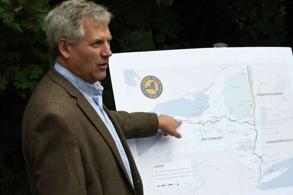 Andy Beers, Empire State Trail director, speaks during a ribbon-cutting ceremony to open a new 5-mile section of the Erie Canalway Trail at the Pattersonville Trailhead near the intersection of Route 5S and Scotch Church Rd. on Wednesday, Oct. 3, 2018, in Pattersonville, N.Y. The pathway is a part of the 750-mile Empire State Trail. (Will Waldron/Times Union)