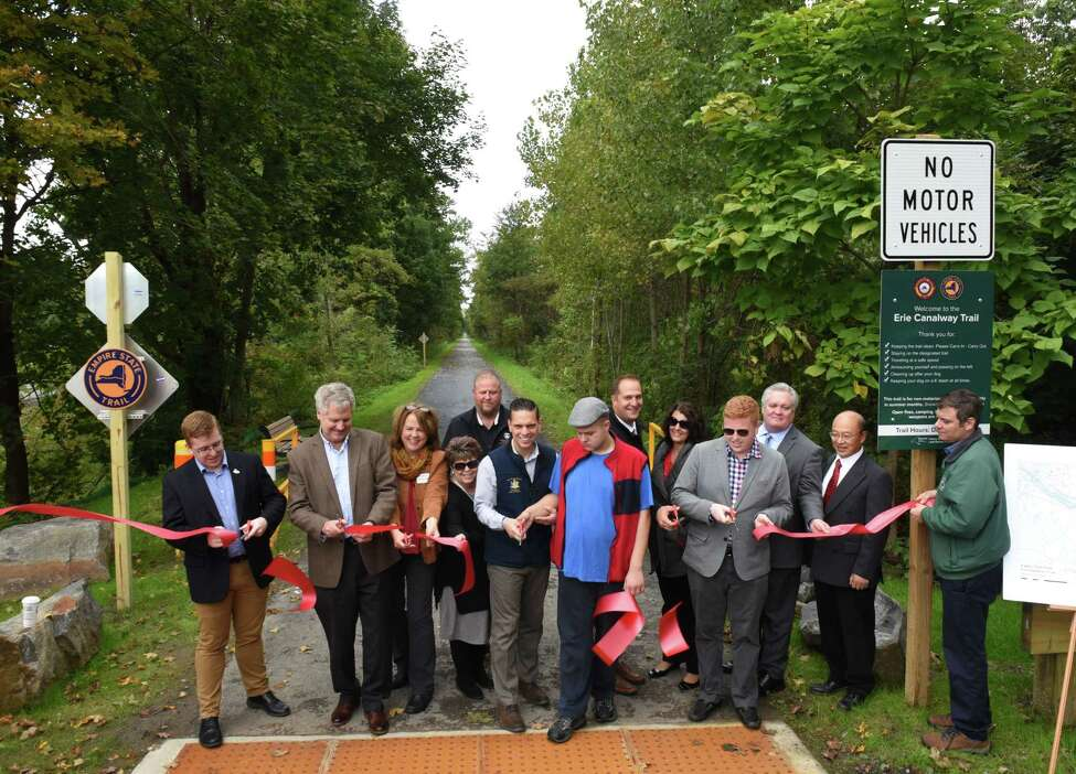 Representatives of New York State Parks, local and state government officials take part in a ribbon-cutting ceremony to open a new 5-mile section of the Erie Canalway Trail at the Pattersonville Trailhead near the intersection of Route 5S and Scotch Church Rd. on Wednesday, Oct. 3, 2018, in Pattersonville, N.Y. The pathway is a part of the 750-mile Empire State Trail. (Will Waldron/Times Union)