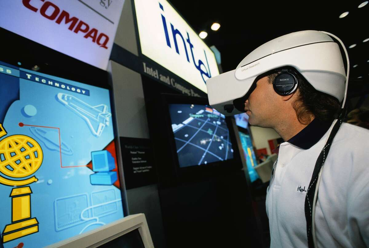 1993: A person tests a virtual reality program at the Compaq Worldwide Technology Summit in Houston, Texas. The virtual reality unit uses a Compaq Pentium processor with Intel chip to give it enough power to produce a real-time simulation.