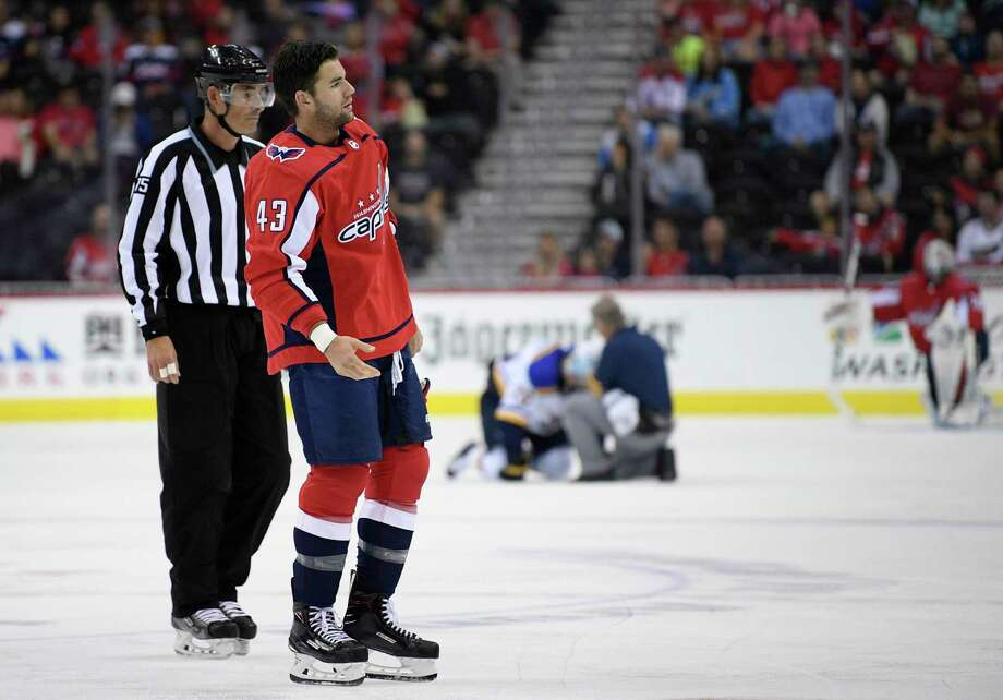 Washington Capitals right wing Tom Wilson (43) is escorted by an official off the ice after he checked St. Louis Blues center Oskar Sundqvist, on ice at back center, during the second period of an NHL preseason hockey game, Sunday, Sept. 30, 2018, in Washington. (AP Photo/Nick Wass) Photo: Nick Wass, Associated Press / Copyright 2018 The Associated Press. All rights reserved.