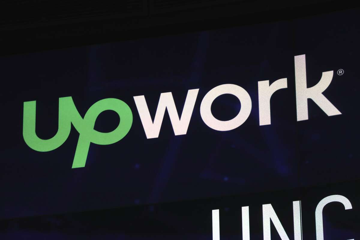 The Upwork logo appears on a screen at the Nasdaq MarketSite, in New York's Times Square, Wednesday, Oct. 3, 2018. (AP Photo/Richard Drew)