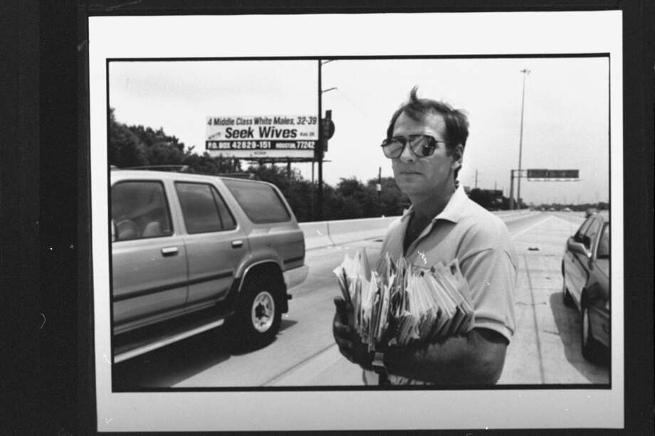 "September 1993: Research technician Bill Machmer, 40, divorced since 1990, is seen holding handful of letters as he stands in front of roadside billboard emblazoned with ""4 MIDDLE CLASS WHITE MALES, 32-39, SEEK WIVES, KIDS OK, WRITE PO BOX 42829-151 HOUSTON"" for which he and three men each paid $2,500 a month for. Photo: Mark Perlstein/The LIFE Images Collection/Getty"