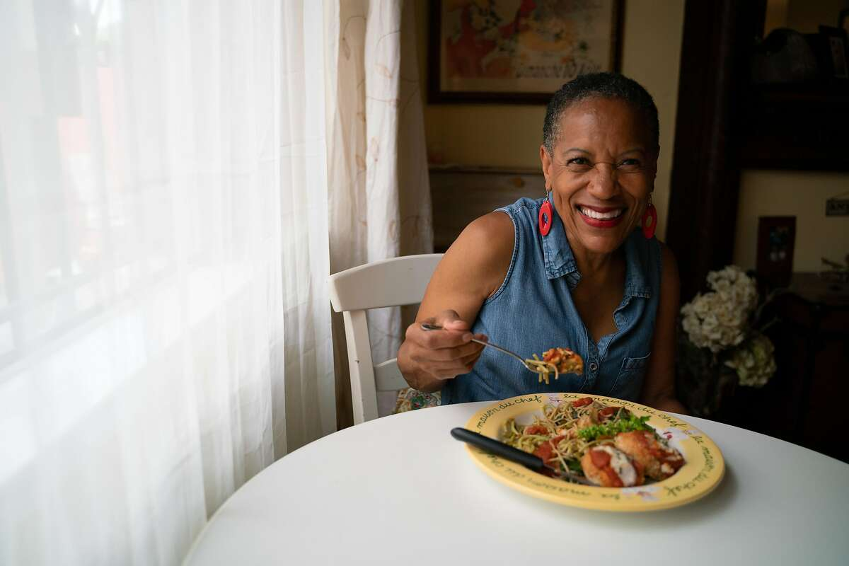 Renee McGhee, 62, tastes her spinach pasta dish with eggplant parmesan, at her home in Berkeley, Calif., on Tuesday, October 2, 2018.