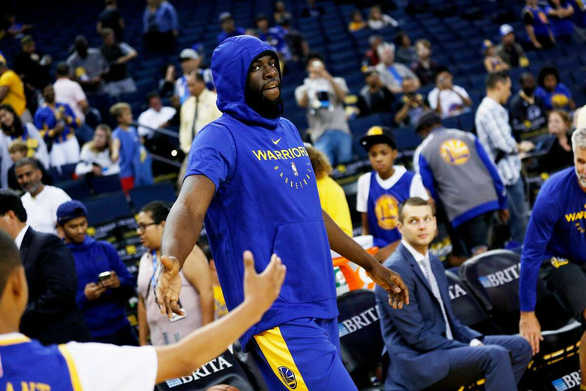 Golden State Warriors forward Draymond Green (23) enters the court to warm up before an NBA preseason game between the Golden State Warriors and Minnesota Timberwolves at Oracle Arena on Saturday, Sept. 29, 2018, in Oakland, Calif.