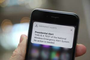 A test of the National Wireless Emergency Alert System is displayed for a photograph on an Apple Inc. iPhone in Washington, D.C., U.S., on Wednesday, Oct. 3, 2018. Federal Emergency Management Agency (FEMA) said Tuesday that today's emergency message is the first nationwide test of the system built by the government and cell phone carriers. Photographer: Andrew Harrer/Bloomberg