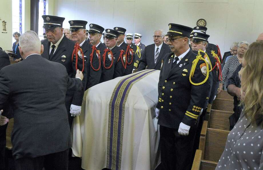 Members of the Sandy Hook Volunteer Fire Department are the pallbearers for retired Fire Chief Michael Lucas, Wednesday morning, Oct. 3, 2018 at St. Rose of Lima in Newtown. Photo: Carol Kaliff / Hearst Connecticut Media / The News-Times
