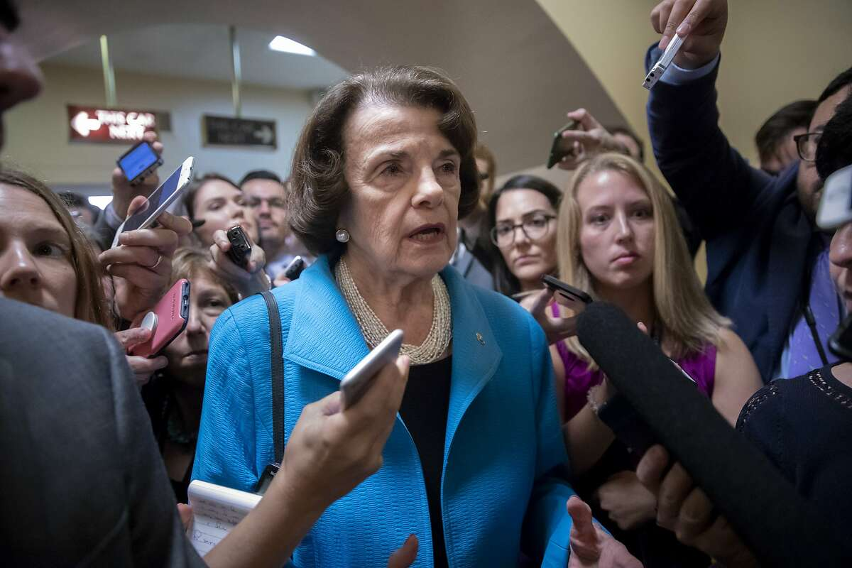 ADVANCE FOR RELEASE SATURDAY, OCT. 6, 2018, AND THEREAFTER - FILE - In this Sept. 18, 2018, file photo, Sen. Dianne Feinstein, D-Calif., the ranking member on the Senate Judiciary Committee, responds to reporters' questions on Capitol Hill in Washington. Feinstein is facing a fellow Democrat State Sen. Kevin de Leon, in the Nov. 6 election because of California's unique primary system that sends the two candidates who receive the most votes to the general election regardless of party. (AP Photo/J. Scott Applewhite, File)
