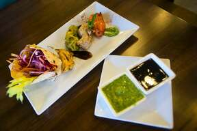 A dish served at Idli Dosa, a new Indian restaurant located at 6811 Eastman Ave, features a mixture of tandoori chicken. The restaurant opens Thursday, Oct. 4, 2018 and features traditional Indian cuisine. (Katy Kildee/kkildee@mdn.net)
