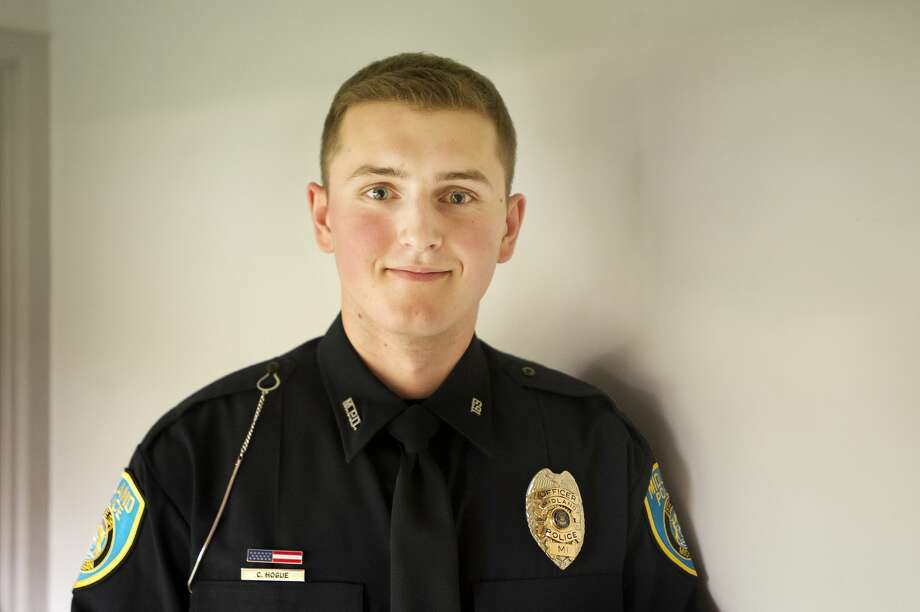 The newest officer of the Midland Police Department, Conner Hogue, poses for a portrait after his swearing-in ceremony on Wednesday, Oct. 3, 2018 at City Hall. (Katy Kildee/kkildee@mdn.net) Photo: (Katy Kildee/kkildee@mdn.net)