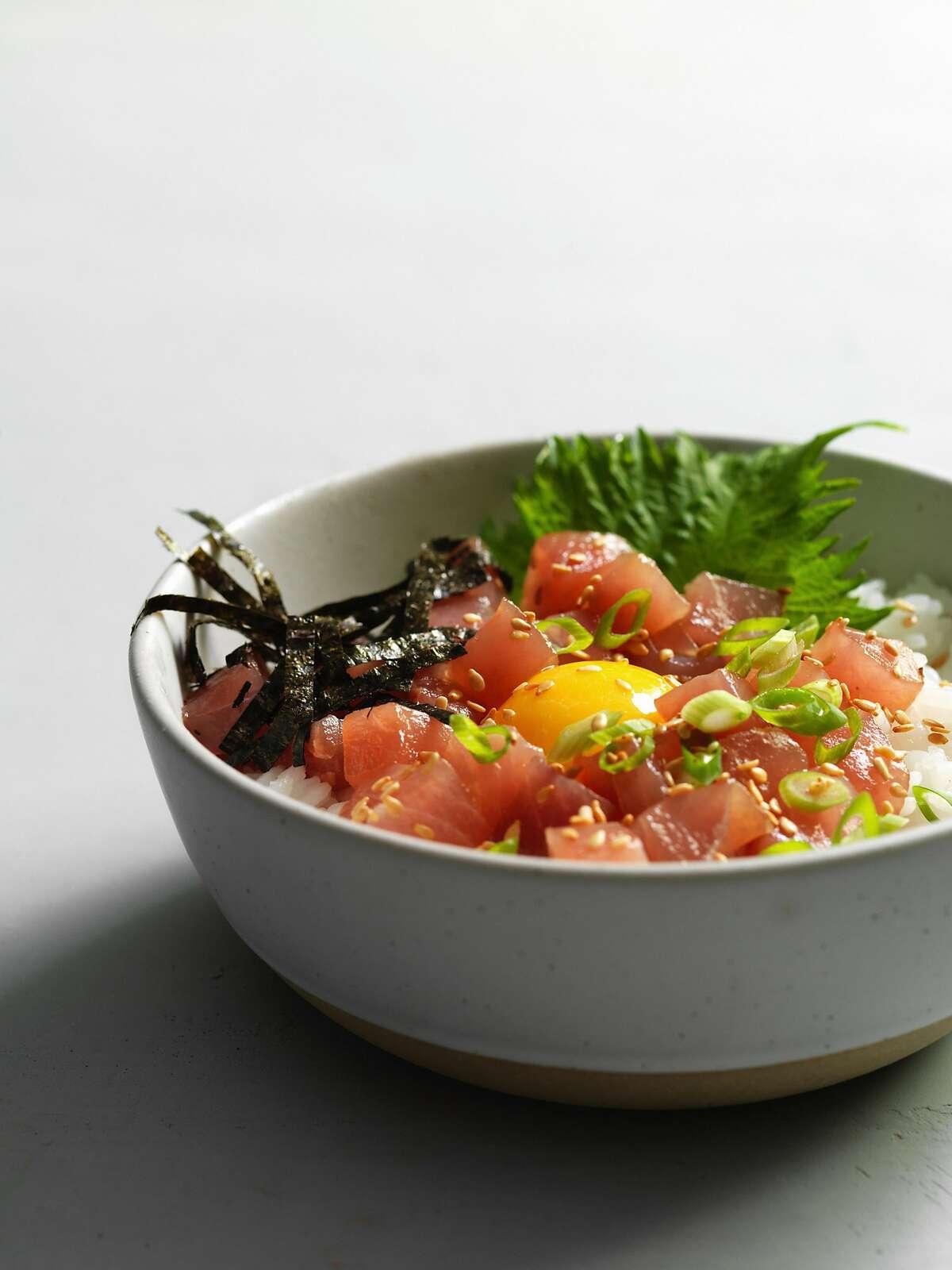 BERKELEY, CALIFORNIA - MAY 2018: Rintaro: Rice dish with marinated tuna, yellowtail, raw egg and nori.