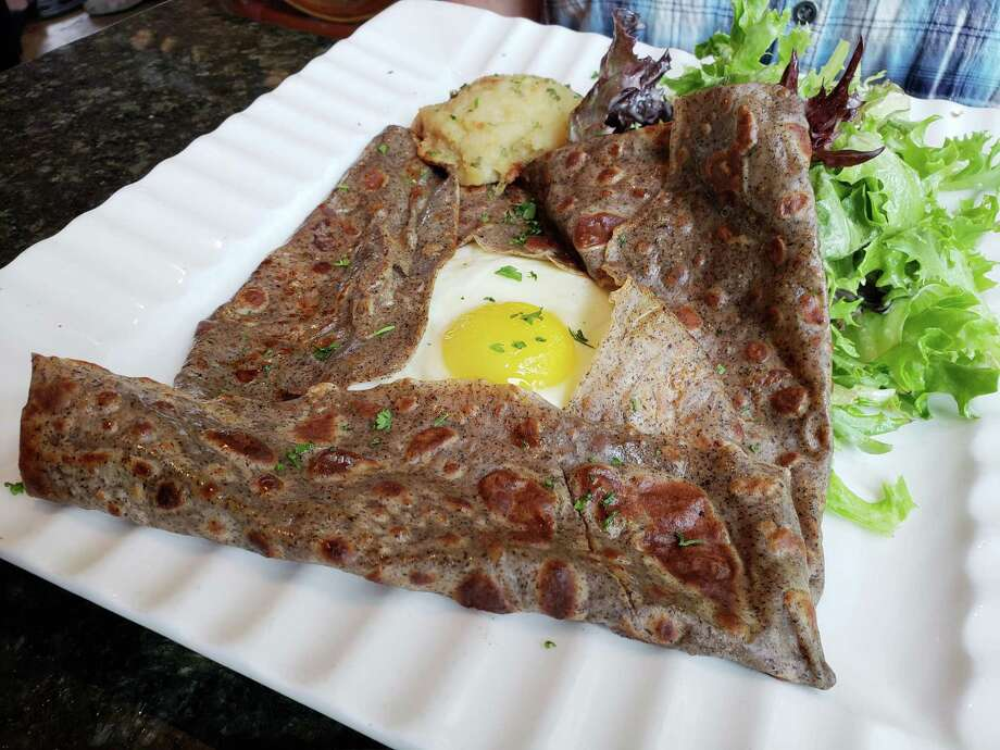 A buckwheat Galette crepe at Sucre Sale in Ridgefield is filled with ham, Swiss and a sunny side egg. Photo: Frank Whitman / For Hearst Connecticut Media / Norwalk Hour freelance