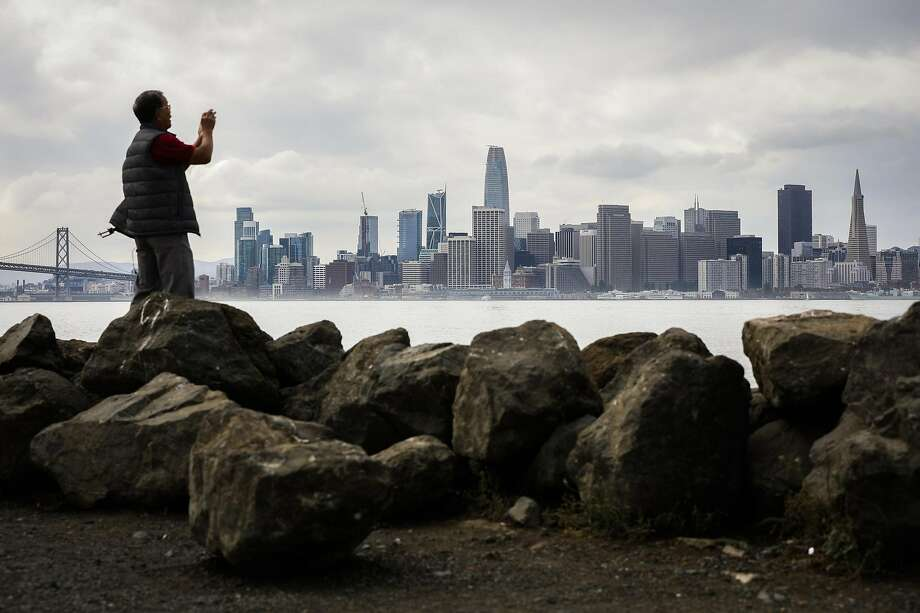 Liem Phan of Oakland takes a photo of the skyline from Treasure Island in San Francisco, California, on Wednesday, Oct. 3, 2018. Photo: Gabrielle Lurie, The Chronicle