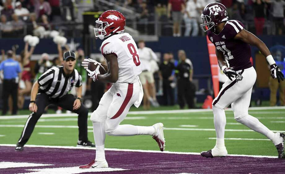 Arkansas wide receiver Michael Woods (8) crosses the goal line ahead of Texas A&M defensive back Charles Oliver (21) on a touchdown reception in the fourth quarter of an NCAA college football game, Saturday in Arlington, Texas. Photo: Jeffrey McWhorter, FRE / Associated Press / Copyright 2018 The Associated Press. All rights reserved