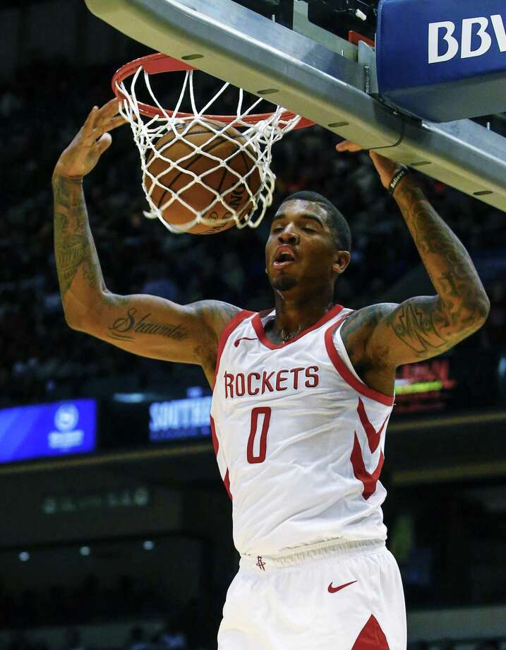 Houston Rockets forward Marquese Chriss (0) slam dunks the ball during the second half of a preseason NBA basketball game against the Memphis Grizzlies, Tuesday, Oct. 2, 2018, in Birmingham, Ala. Houston Rockets won 131-115. (AP Photo/Butch Dill) Photo: Butch Dill, FRE / Associated Press / Copyright 2018 The Associated Press. All rights reserved.