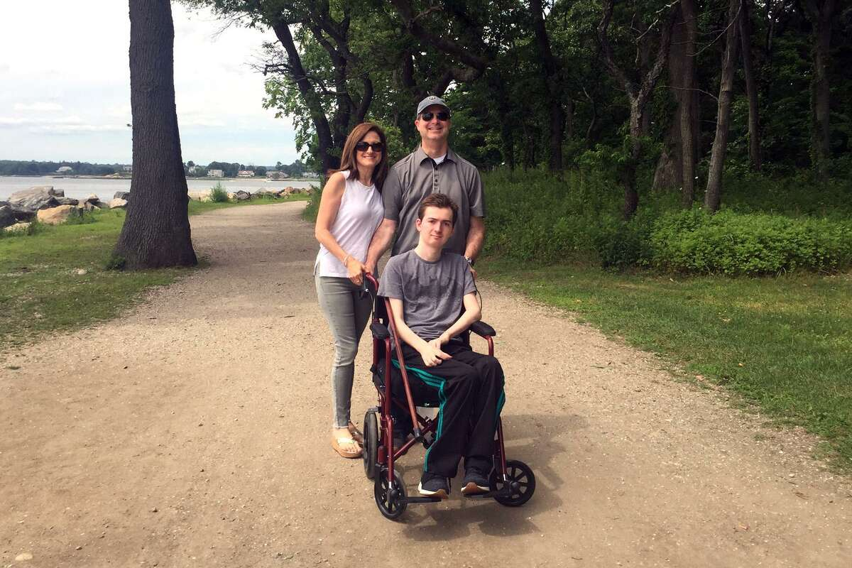 Phil and Andrea Marella pose with their son Andrew at Greenwich Point. Andrew, like his late sister Dana, has the rare disease of Nieman Pick Type C and the non profit Dana?'s Angels Research Trust will hold a special walk at Greenwich Point on Oct. 6 to continue to fund vital research.