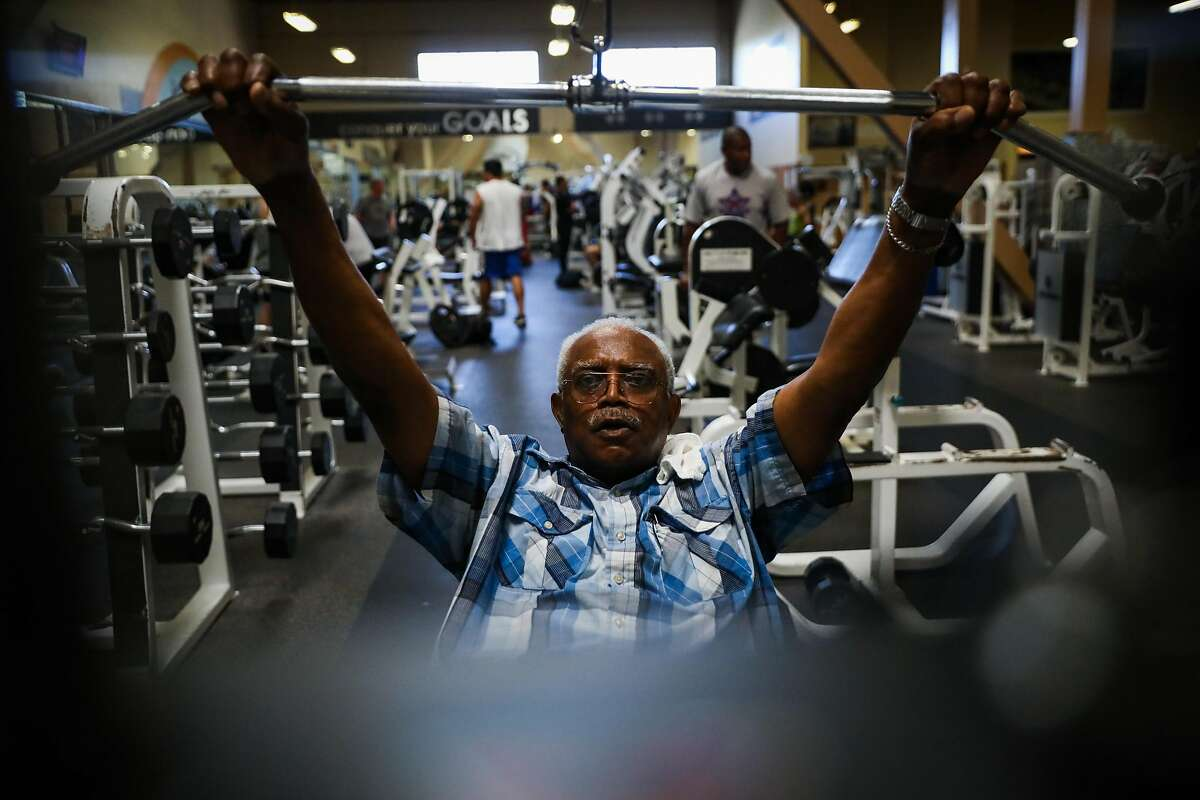 Henry Granger uses a weight machine at 24 Hour Fitness in Santa Rosa, California, on Thursday, Sept. 20, 2018.