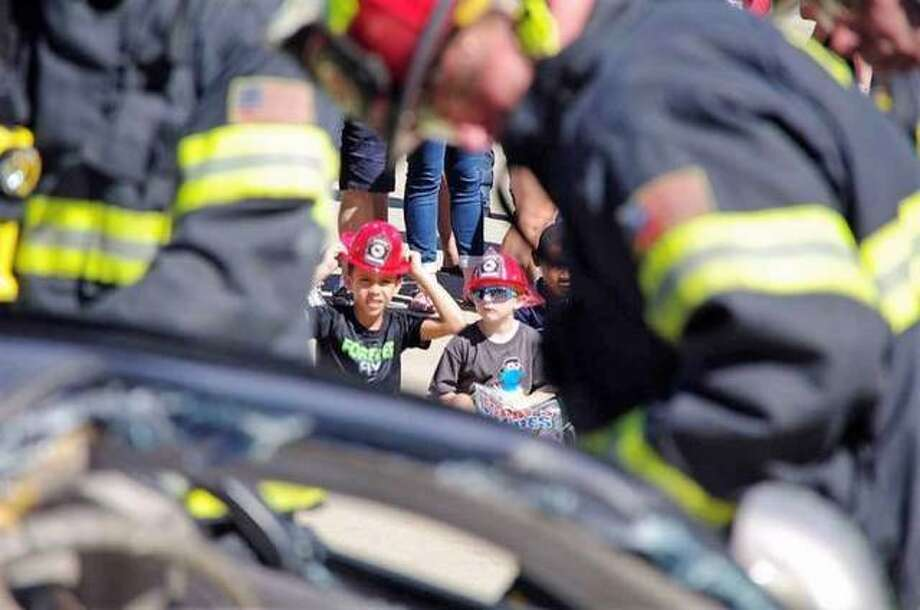Children watch an automobile extrication demonstration during last year's Alton Fire Department Open House.
