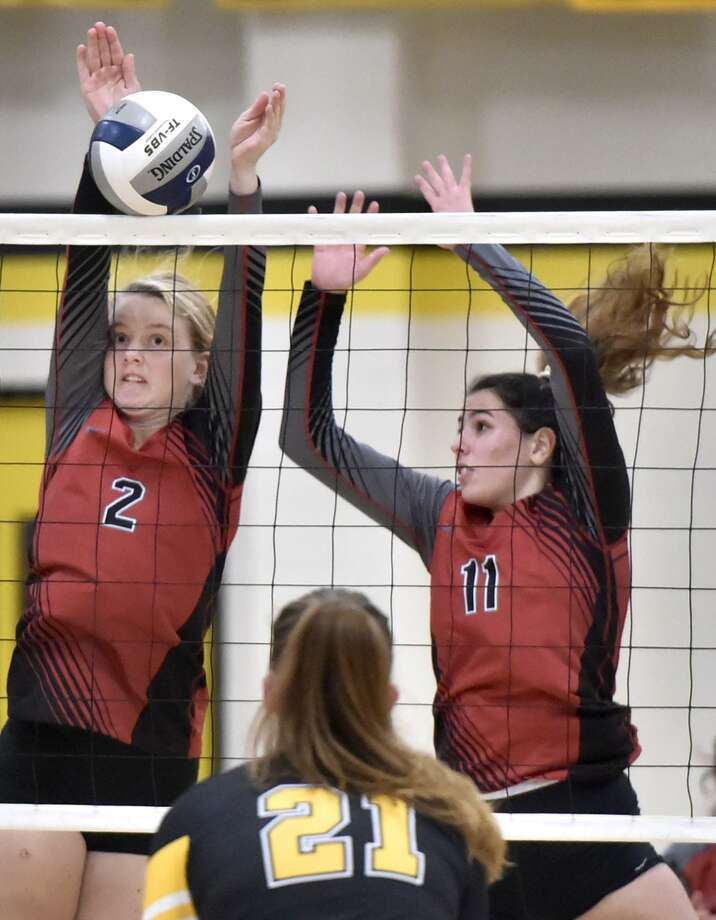 Cheshire's Mia Juodaitis, left, and teammate Julia Bartiet try to block a shot by Amity during a game earlier this season. Photo: Peter Hvizdak / Hearst Connecticut Media / New Haven Register