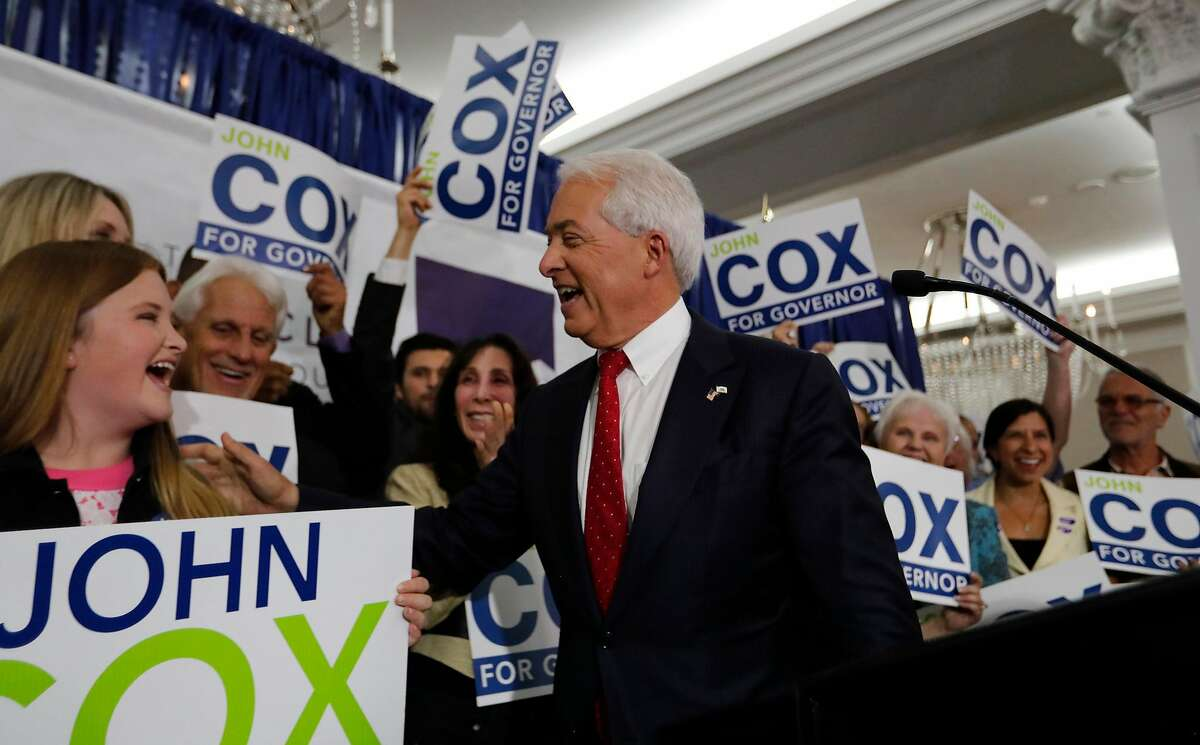 California Republican gubernatorial candidate John Cox celebrates with his daughter Julianne, 13, left, and his wife, Sarah, not pictured, as he addresses supporters at his California Primary election night party at the U.S. Grant Hotel in San Diego on June 5, 2018. (Allen J. Schaben/Los Angeles Times/TNS)