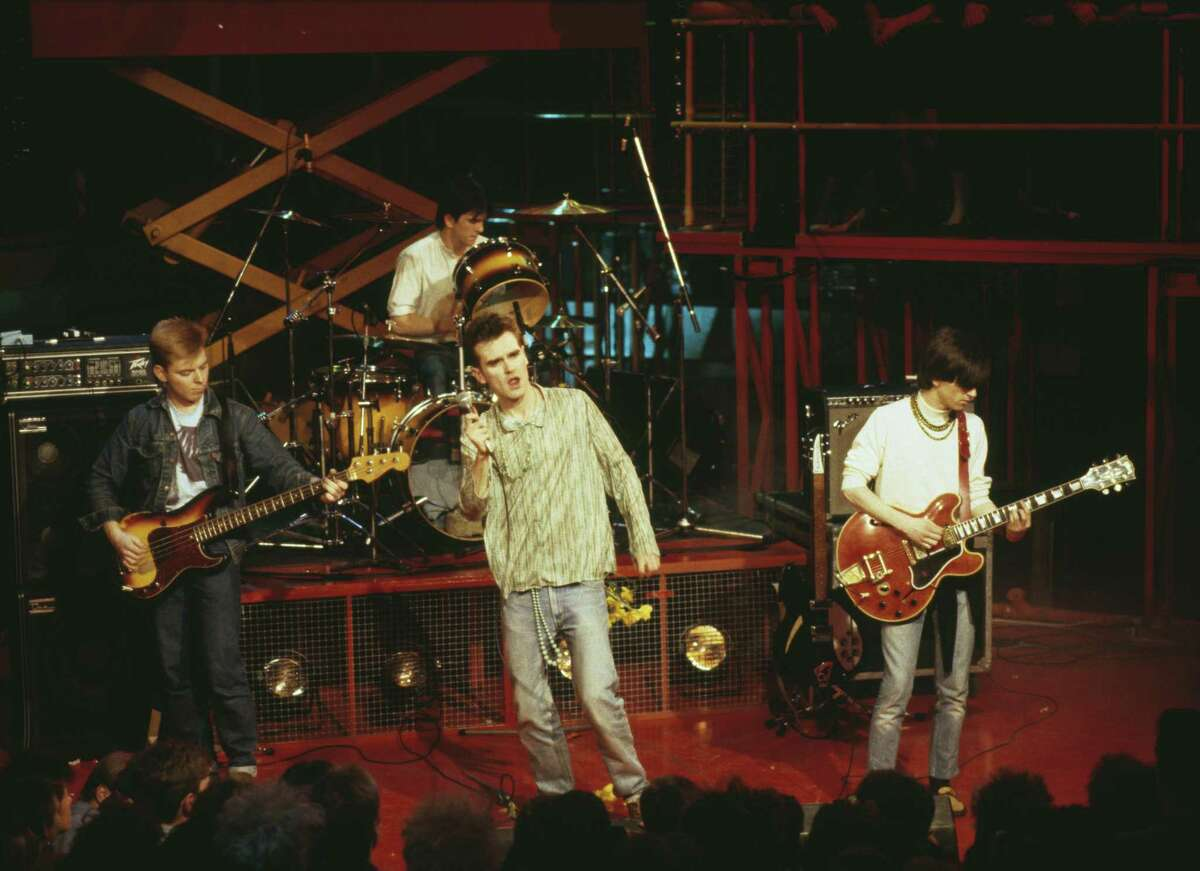 English rock band, The Smiths (L-R; Andy Rourke, Mike Joyce, Morrissey, and Johnny Marr), perform live on stage, 1984.