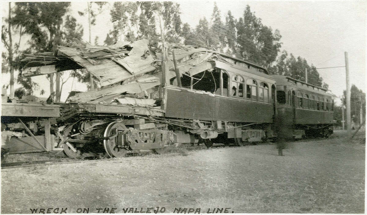 """Caption: """"Wreck on the Vallejo Napa Line."""" Photograph showing some of the train cars involved in a June 19, 1913 accident in which two trains of the San Francisco, Napa Valley and Calistoga Railroad collided head-on approximately 2.4 miles north of Vallejo. Ten passengers and three railroad employees were killed, and twenty-eight others injured. """"McCarthy Album 05, Photograph 036,"""" California State Archives Exhibits, accessed October 3, 2018"""