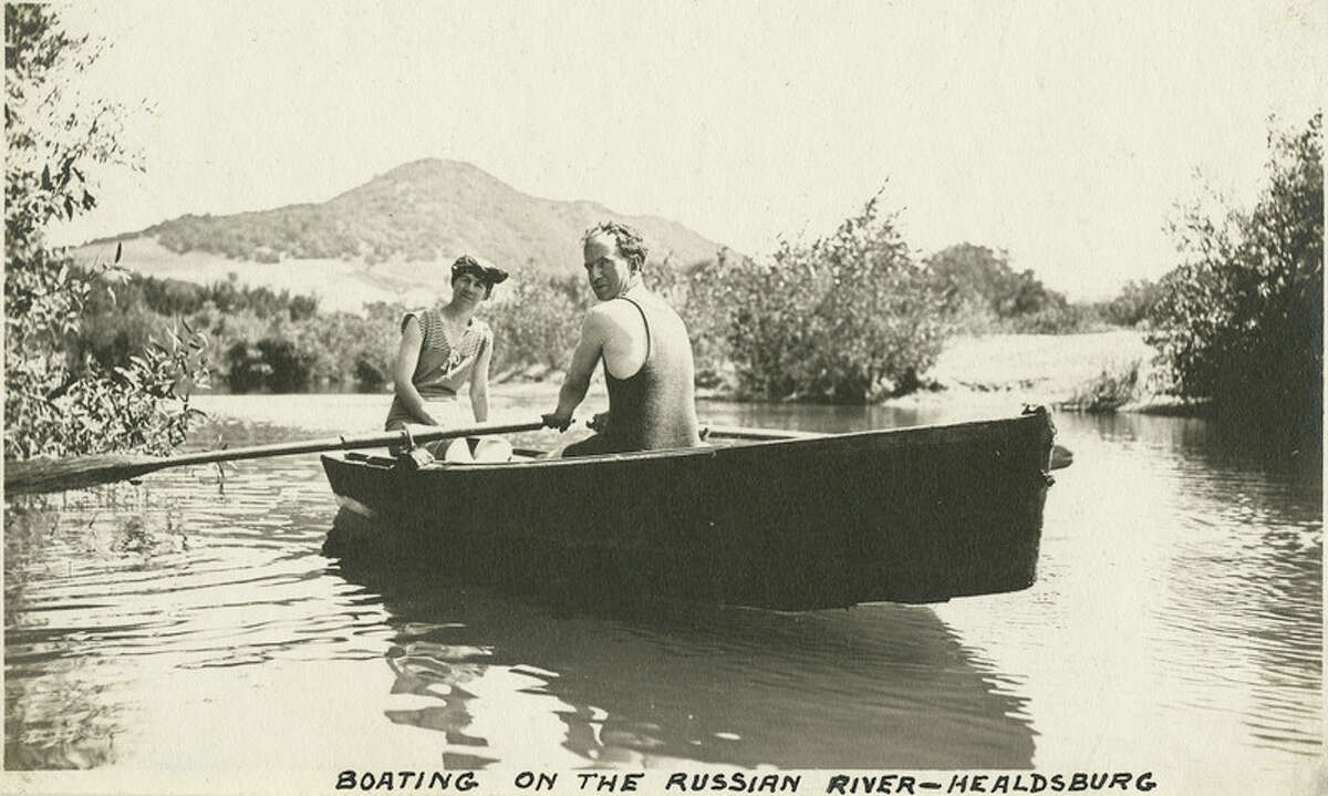 """Caption: """"Boating on the Russian River - Healdsburg,"""" c. 1915, shows Grace and William McCarthy in a row boat on the Russian River at Healdsburg. """"McCarthy Album 07, Photograph 301,"""" California State Archives Exhibits, accessed October 3, 2018"""