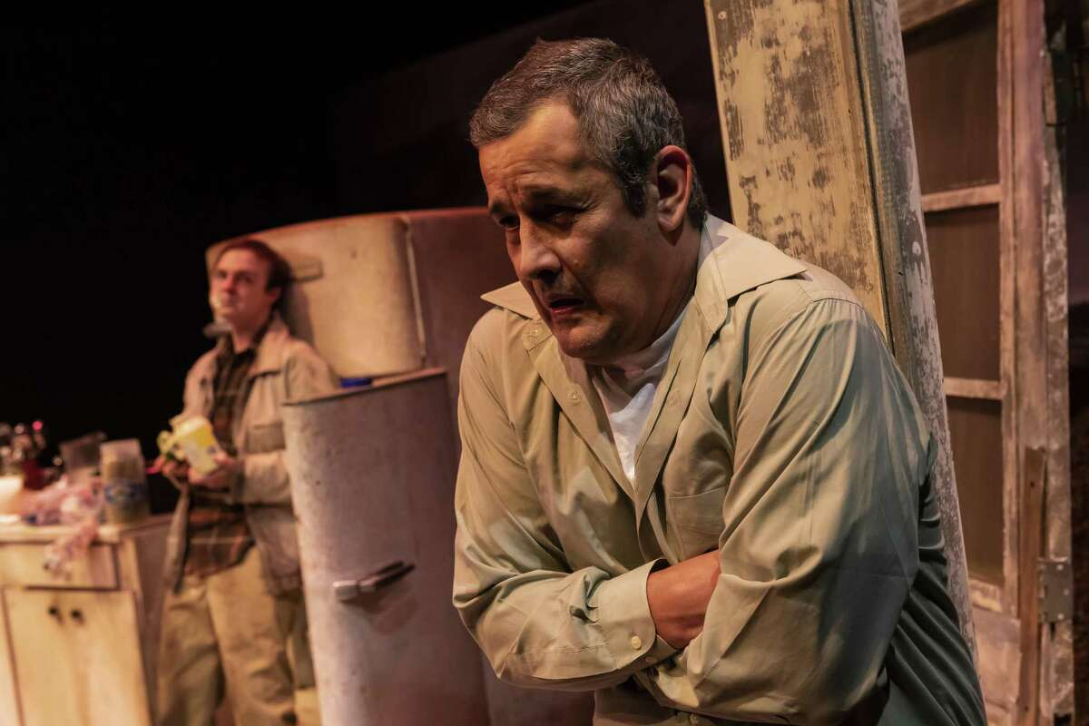"""Luis Galindo in Catastrophic Theatre's """"Curse of the Starving Class,"""" with Jayden Key in background"""
