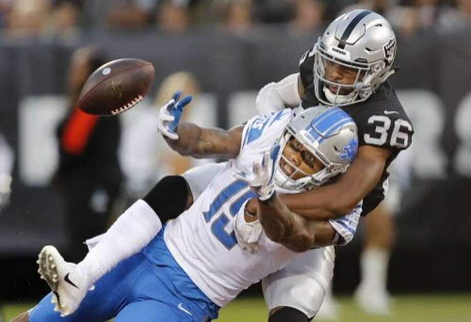 FILE - In this Aug. 10, 2018, file photo, Oakland Raiders cornerback Daryl Worley (36) breaks up a pass intended for Detroit Lions wide receiver Kenny Golladay during the first half of an NFL preseason football game, in Oakland, Calif. The Raiders struggling defense gets a boost this week with the return of cornerback Daryl Worley from suspension. (AP Photo/John Hefti, File) Photo: John Hefti / Associated Press