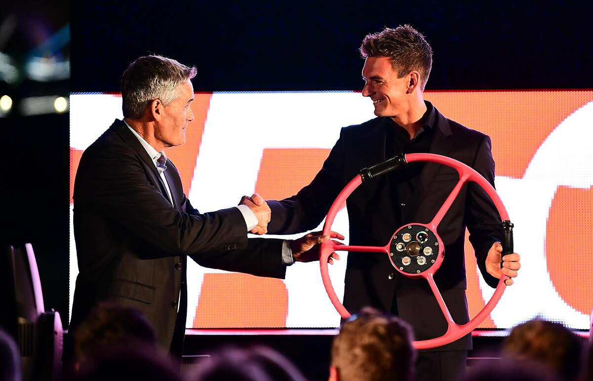 LONDON, ENGLAND - OCTOBER 03: Sir Russell Coutts, SailGP Chief Executive and Dylan Fletcher of Great Britain SailGP on stage during the Global SailGP Launch Event at Tower Bridge on October 3, 2018 in London, England. (Photo by Alex Broadway/Getty Images for SailGP)