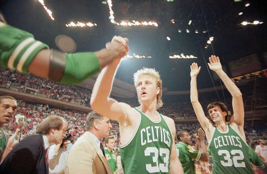Larry Bird (33) gets a congratulation as teammate Kevin McHale (32) goes up with his arms in victory over the Houston Rockets in game four by score of 106-103, Tuesday, June 4, 1986, Houston, Tex. (AP Photo/F. Carter Smith) Photo: F. Carter Smith / AP