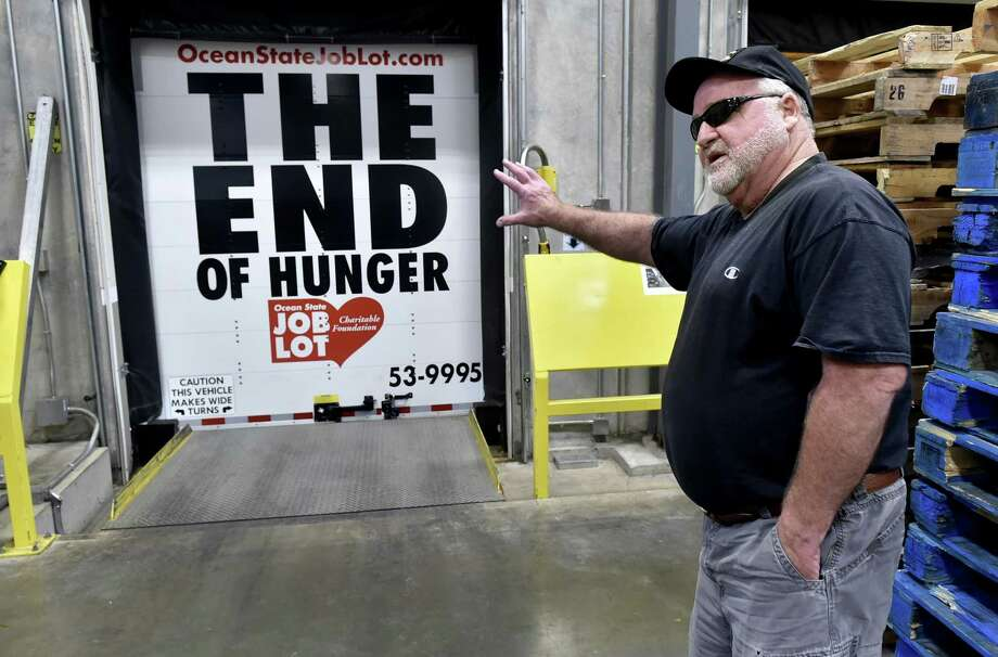 Mike Desmarais, a truck driver for Ocean State Job Lot, shows off the anti-hunger campaign slogan paint job on the back of his truck Wednesday after he  delivered food  to the Connecticut Food Bank warehouse in Wallingford. Photo: Peter Hvizdak / Hearst Connecticut Media / New Haven Register