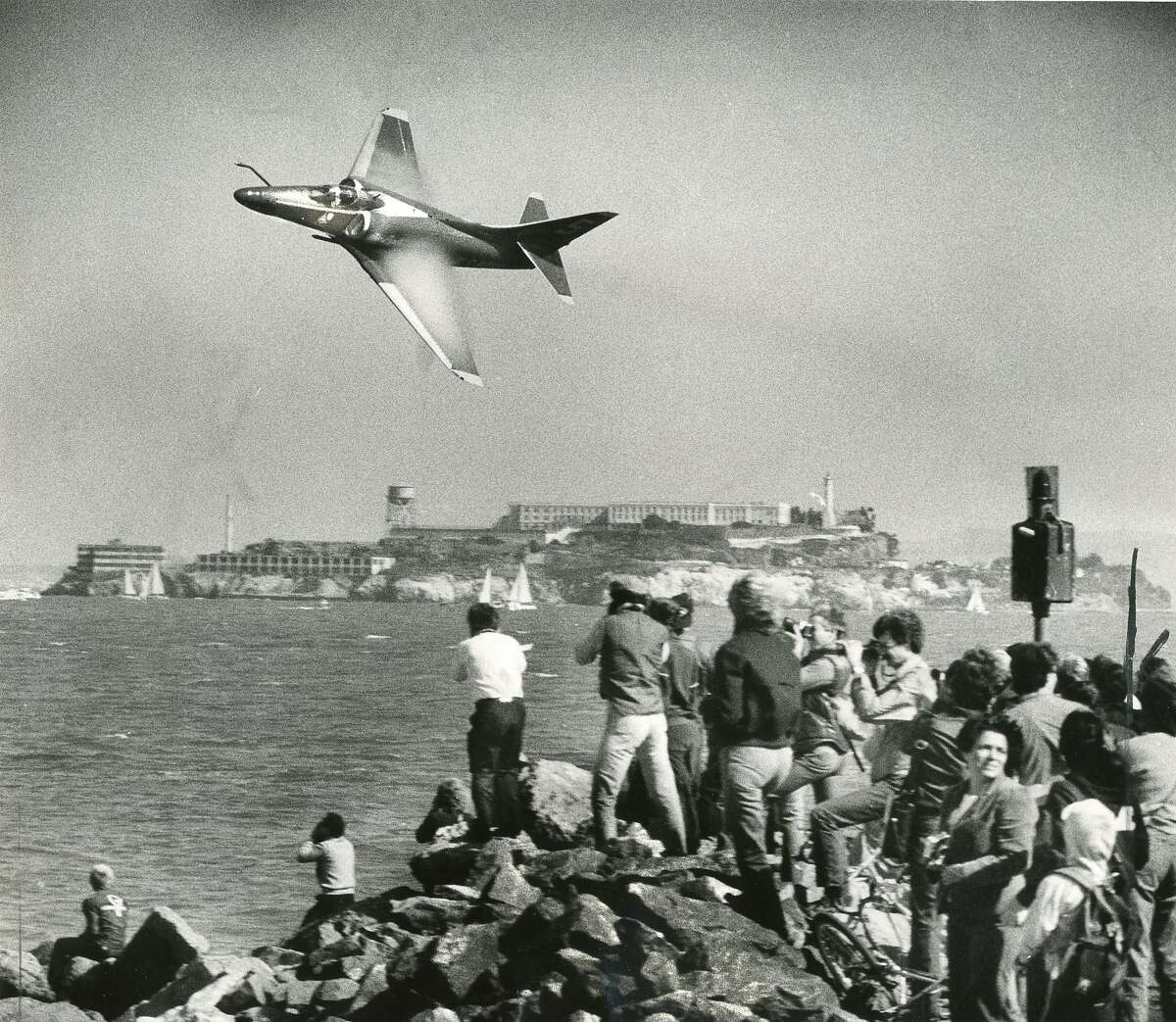 Oct. 13, 1983: The Blue Angels fly by a crowd at the St. Francis Yacht Club jetty during the team's 1983 visit.