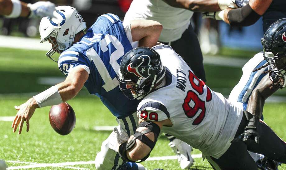 Defensive end J.J. Watt causes a fumble by Colts quarterback Andrew Luck  that the Texans recovered 0b93b3946