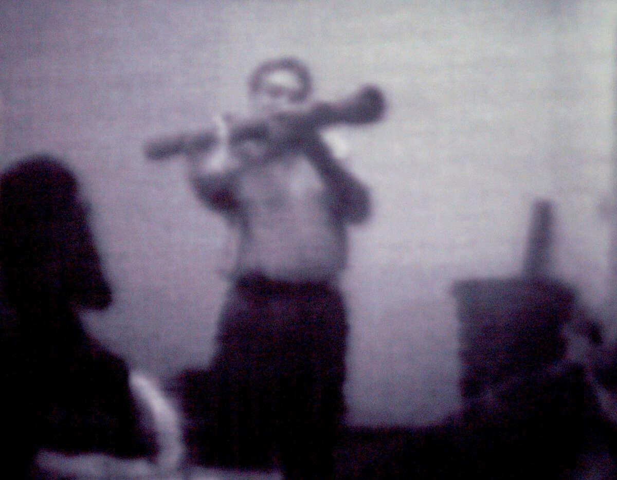 Still image from a surveillance videotape shows informant, shahed Hussain, wielding an inert, inoperable shoulder fired rocket launcher to suspects in a federal terrorism sting in Albany in volving Mohammed Hossain, and Yassin Aref. TIMES UNION