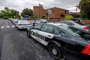 A large number of police vehicles sit outside of Albany High School after a call from the school for backup after a large fight broke out Wednesday Oct. 3, 2018 in Albany, N.Y. (Skip Dickstein/Times Union)