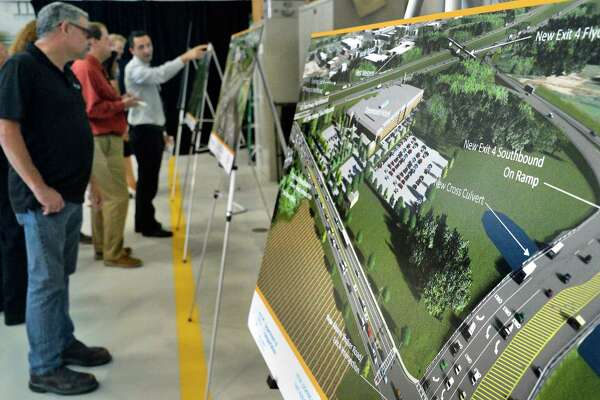 Artist concepts of a $92 million investment in the Capital Region that will connect I-87 motorists directly with Albany Airport via Exit 4, a new parking garage and other improvements on display during a news conference at the airport Tuesday August 14, 2018 in Colonie, NY. (John Carl D'Annibale/Times Union)